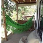 Each cabin has a private deck with a hammock and a beach bean bag.