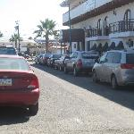 View of front of hotel and street parking