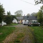 An exterior photo of the main property - it's a small farming o