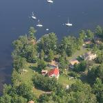 Arial view of owners home/cabins and neighbors