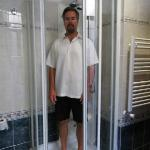 The tiny shower with my average husband inside!