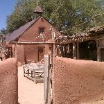 an old church and sheep corral at the original ranch
