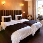 Village View, a beautiful twin room with a window seat overlooking the village
