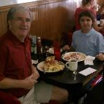 Grandson with strawberry waffle, grandpa with omelet