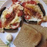 Fried eggs with mushrooms and tomato for breakfast