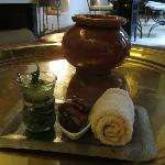  Welcome drink of lemon juice and mint, with stuffed dates and a cool towel.