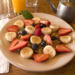  Breakfast of fresh fruit and granola, fresh squeezed OJ