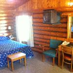 Inside cabin. Desk and bed.