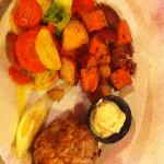 Crab cake dinner with vegetables and potatoes