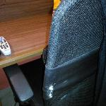 Poor quality torn fabric writing desk chair