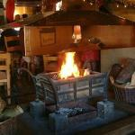 Welcoming log fire in the dining room