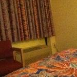  you can see the window shades and bed quilt