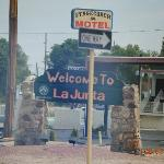 Welcome to La Juanta sign with the hotel in the background