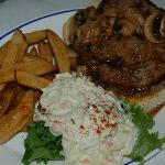 Our hand cut 6 oz. open steak sandwich with either mushrooms & onions or crispy fried onion ring
