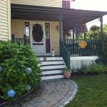  Welcoming front porch, complete with cat!