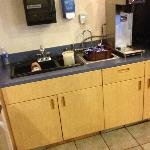 service area with dirty sink and pitcher filled with unknown