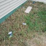  Trash and beer cans outside of building