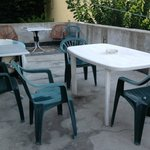 Terrace with dirty chairs...