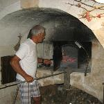 Ron Loading the Pizza in the Oven