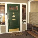 This lovely outer door next to benches for visiting keeps the house secure with a keypad.
