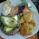 Arroz congri with tostones and Chicken.