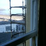  Heavy sash window held up with wood
