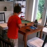  Playing mini-pool in the breakfast room