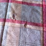 1 of 7 ciggeratte burns in my bedspread (non smoking room)