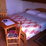 The bed and a small writing table