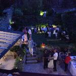The private garden by night with a private party
