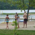 The kids getting ready to swim in lake