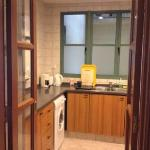 kitchen in 1 bedroom suite. Front loading washing machine