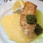 Incredible fresh sturgeon on a bed of polenta with fresh corn, fresh pesto and evoo