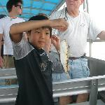  One of my kids holding up a puffer fish he caught on this trip