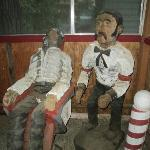 Carved wooden figures around the property