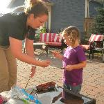  Korina making smores with our daughter