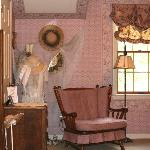 Ten Bedrooms decorated with country and Victorian antiques.