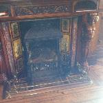 carved fireplace in the lounge