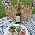 Picnic hamper on the lawn - delicious al fresco lunching!