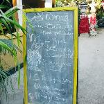 A signboard outside Adi's that states what's on the menu for the day