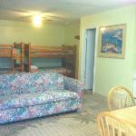 Large Kitchenette with Queen bed, two bunk beds and hide a bed.