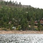  View of the lodge, burned pines, and nearby private cabins from the water