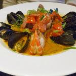 Steamed Shellfish Sofritto: prawns, mussels, scallop over risotto
