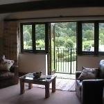Looking across the room to the patio doors and balcony