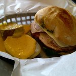 Sanguche Pervano has egg, cheese, spinach, and Peruvian ham. With warm potato slices and spicy s