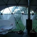 Inside Dome with hanging bed and wood stove