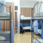 dorms with curtain on the bunk