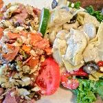  The antipasto and marinated artichoke salads.