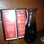 menu and bottle of sangria.
