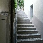  Stairway to a guest room and courtyard